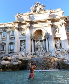 Italian famous TV disturber, Gabriele Paolini, it dives into the Trevi Fountain, Rome, on 23 December 2011.  ANSA/CLAUDIO ONORATI